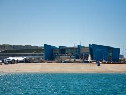 View of the back of the building and the dinghy park from the water © Tom Martin