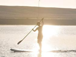 Stand Up Paddle Boarding in the Evening Sunshine