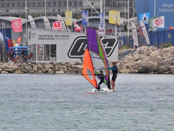 Adult and Child Windsurfing